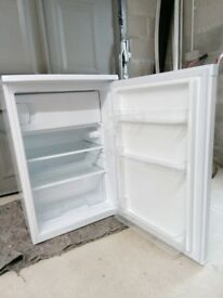 Unused fridge with small freezer compartment