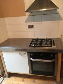 Freestanding electric oven, gas hob, extractor fan, worktop and shelving. 57x26 inches. Must go asap