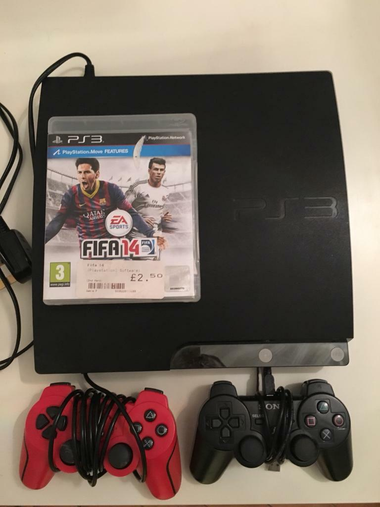 PS3 PlayStation 3 with two controllers and FIFA 14 game