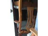 Sold oak wood dining table and 4 chairs
