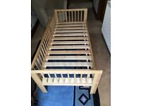 Ikea toddler bed with extra side guard