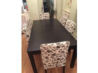 Stylish dining table and 6 floral design chairs..good condition..table can also be extended