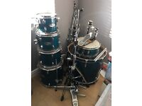 Mapex M series full drum kit, additional cowbell and double bass pedal.