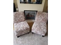 Two designer beige floral material chairs. £40 each