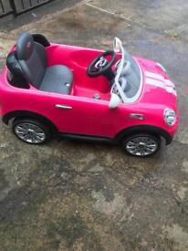 Children's pink mini cooper