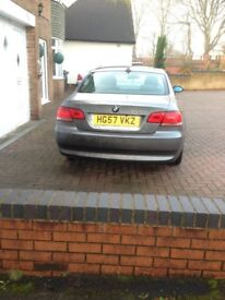 GREY BMW 320D COUPE
