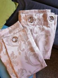 A Beige pair of Curtains