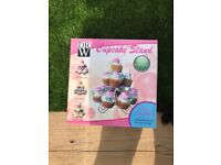 Mini cupcake maker in pink and cupcake holder in silver swirls