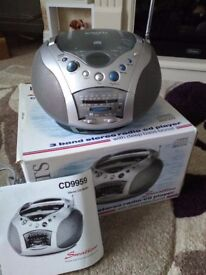 Stereo radio CD player as new, mains/ battery, instructions, still in box , make ideal gift.