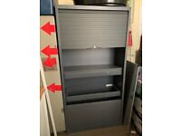 Grey office metal cupboard with plastic roller shutters