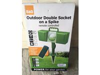 Outdoor double socket on a spike with remote control