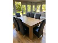 Solid Oak dining table and 8 dark brown leather chairs