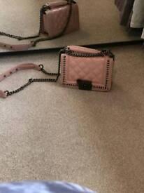 Pink and black handbag