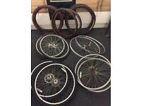 2 sets of Mountain bike wheels with tyres. And set of hybrid wheels.