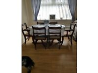 SOLID DARK WOOD TABLE AND 6 CHAIRS
