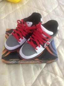 White Black grey & red heeleys Size 5