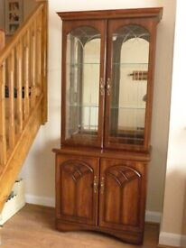 Dark wood dresser with glass fronted display cabinet and cupboard base.