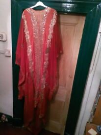Khaleegi thobe (dress) in red with gold embroidery and sequins