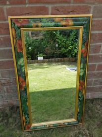 Wall mirror with floral frame