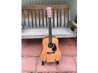 Martin DX1AE acoustic guitar.