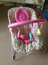 Pink baby bouncy chair