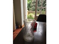 2 glass vases for sale.