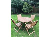 Wooden garden table and four chairs
