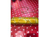 Mustard honeycomb effect clutch bag