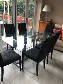 Glass top dining table with chairs