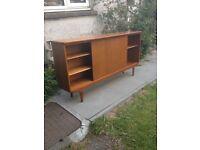 A & H McIntosh Long Slim Teak Glass Sliding Door Bookcase/Cabinet
