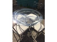 Glass top dining table and chair
