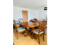 Stylish wooden dining table and chairs
