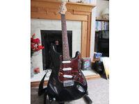 Luthier built Strat, brilliant guitar sounds great.