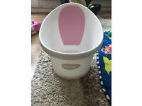 Shnuggle baby bath in pink bathtub newborn girl