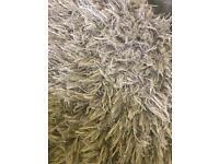 Grey shaggy rug.