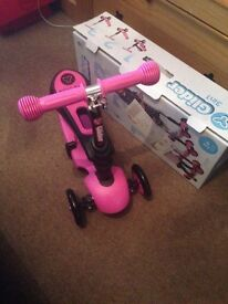 New boxed scooter sit n stand
