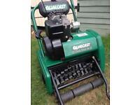 Petrol lawn scarifier / lawnmower.