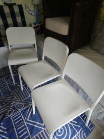 3 white Ikea kitchen chairs