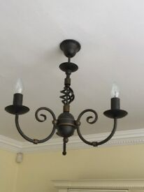 2x Black wrought iron light fittings with gold trim