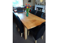 OAK EXTENDABLE DINING TABLE AND SIX CHAIRS £40