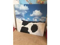 Giant IKEA picture with side of a cow on it