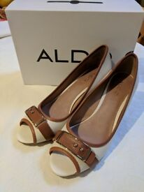 Brand new ALDO cream and tan wedges - size 7