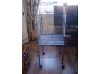 L@@K: PARROT/BIRD CAGE ON STAND GOING CHEEP. COULD DELIVER. PLEASE READ FULLY.