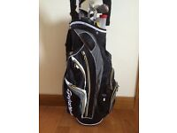 Taylor Made Bag, golden bear clubs and trolley.