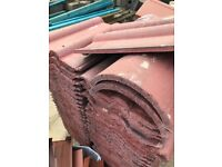 Interlocking double roman roof tiles in farmhouse red