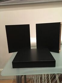 IKEA black wooden wall shelves