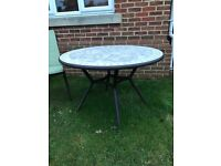 Mosaic metal garden table and 5 chairs with cushions. Unused