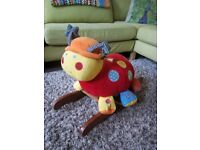 Lotty ladybird baby toddler rocker with music and rattles.