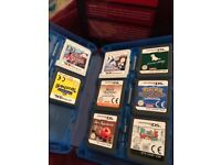 Red Nintendo 3DS plus games and cases