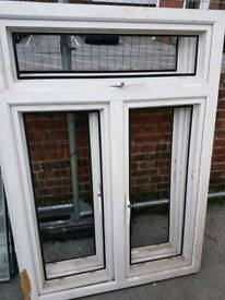 Two double glazed window units